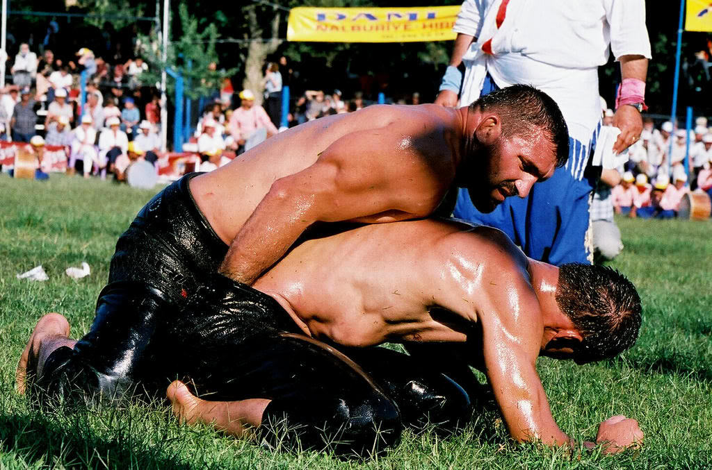 Nude men oil wrestling